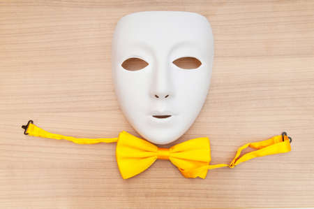 Masks and bow ties on the wooden background Stock Photo - 8460083