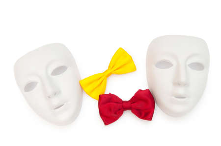 Masks and bow ties isolated on the white photo