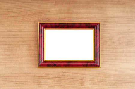 Picture frames on the polished wooden background photo