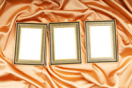 Picture frames on the color satin background Stock Photo - 8614267