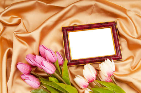 Picture frames and tulips flowers on satin photo