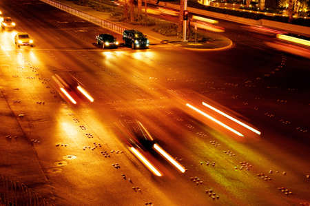 Moving traffic and car lights in the evening photo