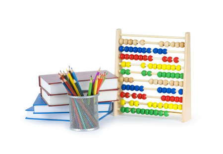 Education concept with pencils, books and abacus photo