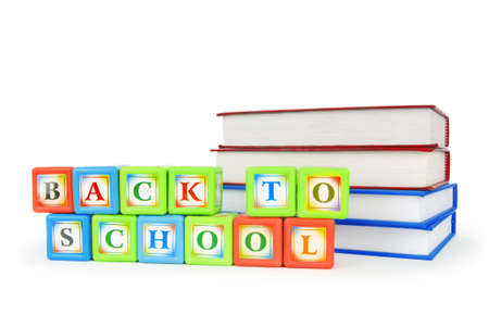 Books and alphabet blocks isolated on white photo