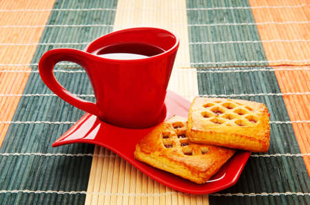 Cup of tea and fresh cookies on table photo