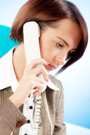 Young businesswoman talking on the phone Stock Photo - 8627997