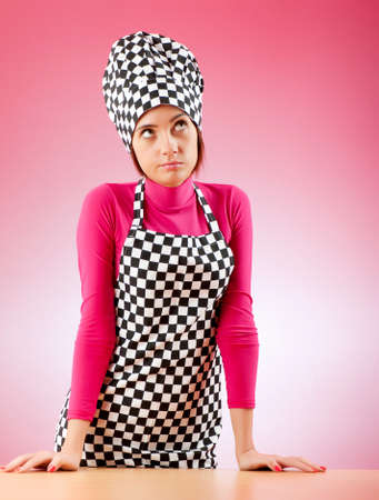 Young female cook against gradient background Stock Photo - 8627991