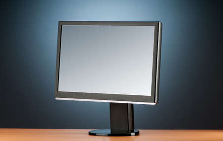 Wide screen computer monitor against colorful background photo