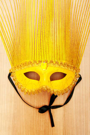 Ornate masks isolated on the wooden background Stock Photo - 8615476