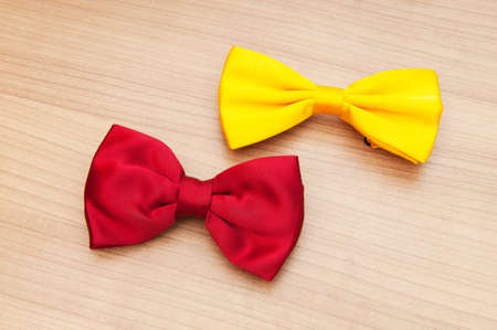 Two bow ties on the wooden background Stock Photo - 8615951