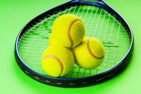 Tennis concept with balls and racket photo