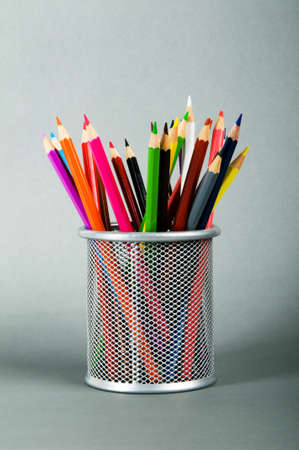 Many colorful pencils on the color background photo