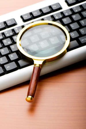 Computer security concept with keyboard and magnifying glass Stock Photo - 8657326