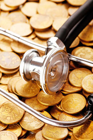 Concept of expensive healthcare with coins and stethoscope Stock Photo - 8657195