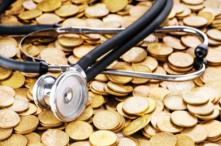 Concept of expensive healthcare with coins and stethoscope Stock Photo - 8657233