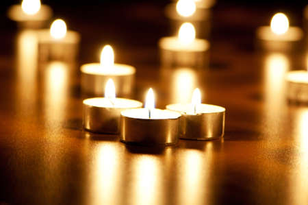 Many burning candles with shallow depth of field Stock Photo - 8657236