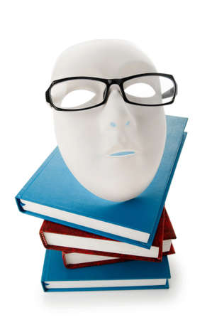 Reading concept with masks, books and  glasses photo