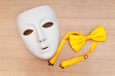 Masks and bow ties on the wooden background Stock Photo - 8657201