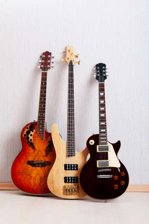 Musical concept with wooden guitar photo