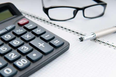 Business concept with notepad and calculator photo