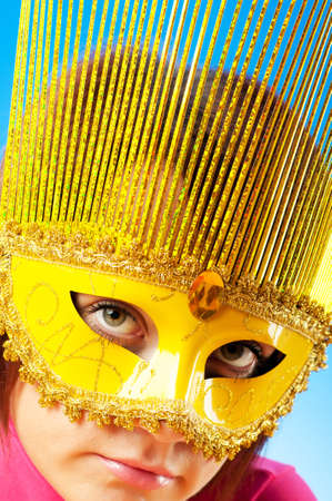 Attractive woman posing in the stylish mask photo