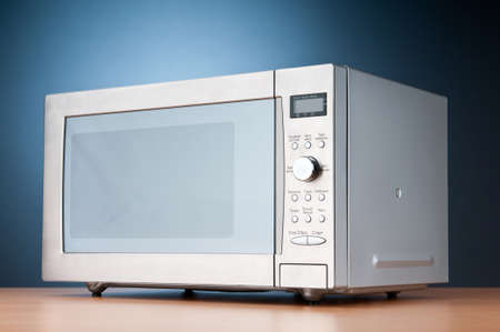 defrost: Microwave oven on the table