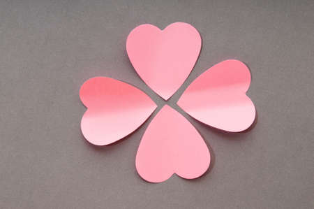 Heart shaped sticky notes on the background photo