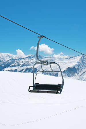 Ski lift chairs on bright winter day  photo