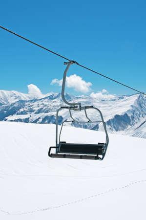 Ski lift chairs on bright winter day  photo