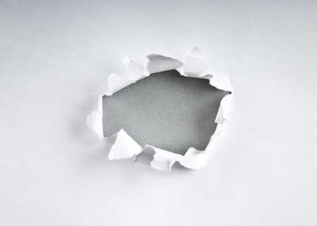 Hole in the paper with torn sides photo
