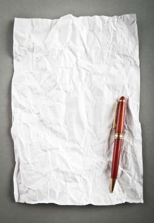 Wrinkled paper background with pen Stock Photo - 8741578