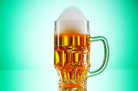 Beer glasses against the colorful gradient background Stock Photo - 8742079