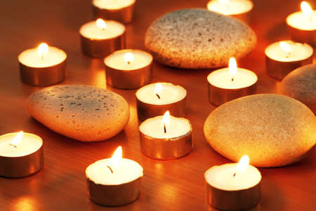 Burning candles and pebbles for aromatherapy session Stock Photo - 8740636