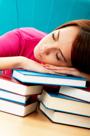 Young female student with many study books Stock Photo - 8744933