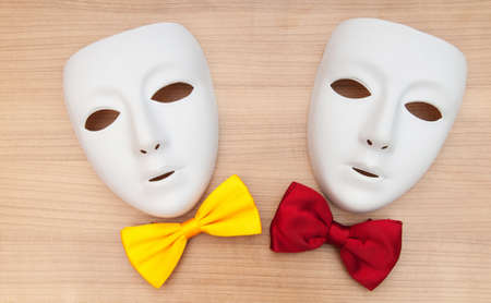 Masks and bow ties on the wooden background Stock Photo - 8738397