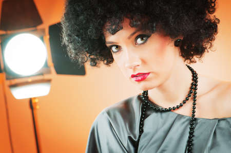 Young attractive girl with afro curly haircut photo