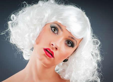 Blonde puppet in studio shooting photo