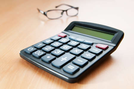 Business concept with accounting calculator  photo