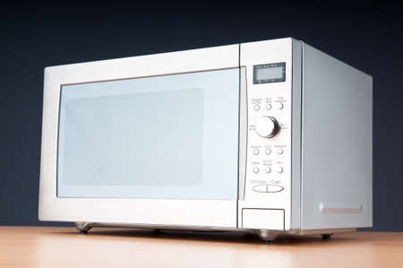 Microwave oven on the table photo
