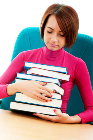Young female student with many study books photo