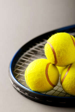 raquet: Tennis concept with balls and racket Stock Photo