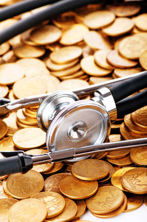 Concept of expensive healthcare with coins and stethoscope Stock Photo - 8882046