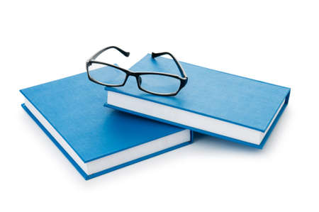 Reading glasses with books isolated on the white Stock Photo - 8882236