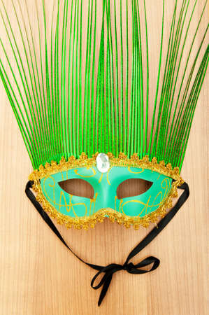 Ornate masks isolated on the wooden background Stock Photo - 8882018