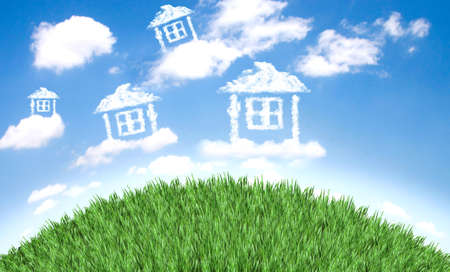 day dream: Cloud houses in the air over grass field Stock Photo