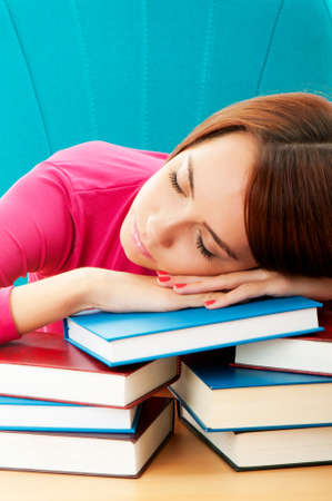 Young female student with many study books Stock Photo - 8964998