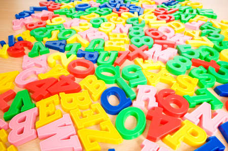 Children letters and digits on the table photo