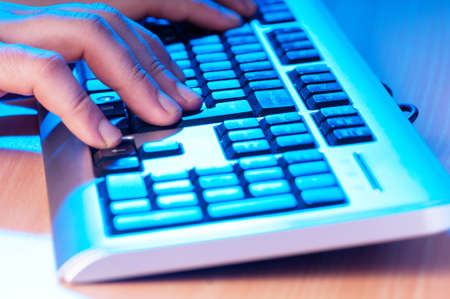 Two hands working on the silver keyboard Stock Photo - 8949336