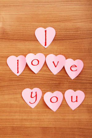 Heart shaped sticky notes on the background Stock Photo - 8942638