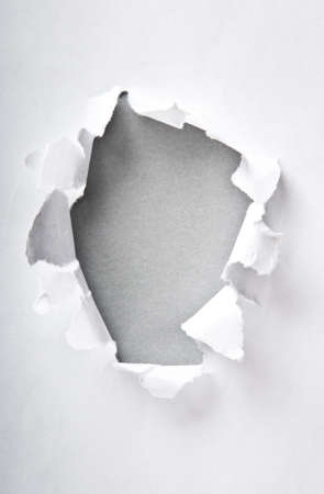Hole in the paper with torn sides Stock Photo - 8943105